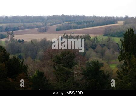 Beautiful landscape view of Buckinghamshire, UK countryside with a tractor in the distance - Stock Photo