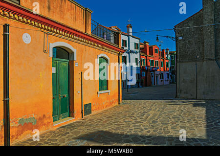 Overview of colorful terraced houses in an alley, in the sunset at the city center of Venice, the historic and amazing - Stock Photo