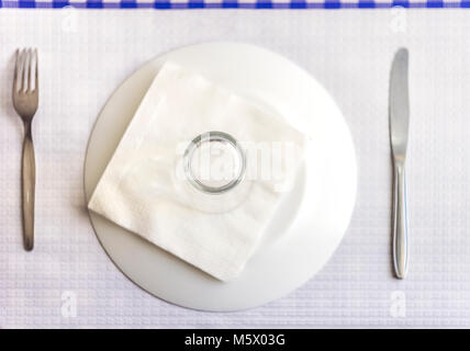 Single tableware - plate, fork, knife, water glass and napkin in the restaurant - Stock Photo