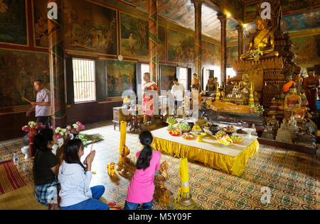 Tourists and local people worshipping; Wat Phnom Temple, a buddhist temple in Phnom Penh, Cambodia Asia - Stock Photo