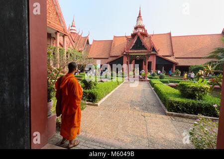Cambodia  monk in the garden of the National Museum of Cambodia, Phnom Penh, Cambodia Asia - Stock Photo