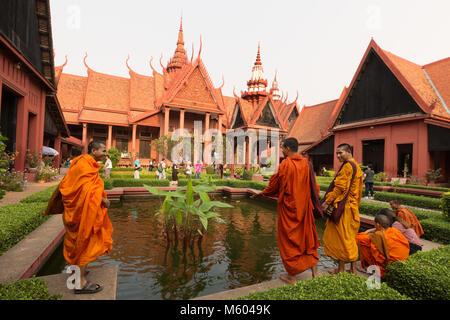Cambodia  monks in the garden of the National Museum of Cambodia, Phnom Penh, Cambodia Asia - Stock Photo