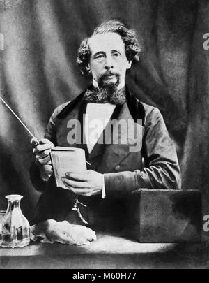 CHARLES DICKENS (1812-1870) English novelist about 1860 showing how he delivered his live presentations of his works. - Stock Photo