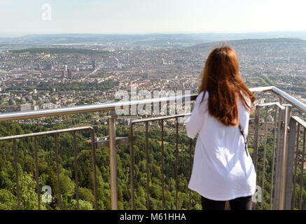 Female tourist enjoying cityscape of Zurich view from Uetliberg, Switzerland. - Stock Photo