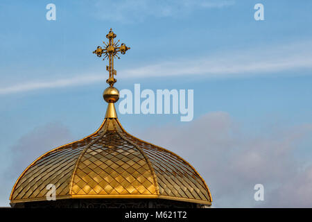Gilded dome of orthodox Christian church shines on the blue sky background - Stock Photo