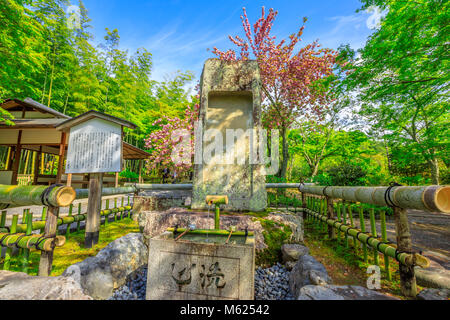 Kyoto, Japan - April 27, 2017: fountain in the Hyakka-en garden in the north side of Taho-den Hall inside Tenryu - Stock Photo