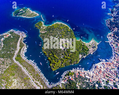 Gaios, capital city of Paxos Island near Corfu, aerial view. Grand canal, old harbor and fortress visible from above. - Stock Photo
