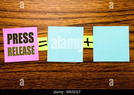Writing text showing Press Release. Business concept for Statement Announcement Message written on sticky note paper - Stock Photo