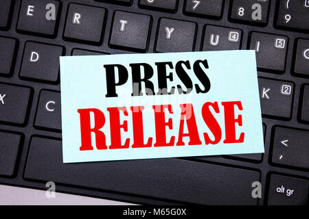 Word, writing Press Release. Business concept for Statement Announcement Message written on sticky note paper on - Stock Photo