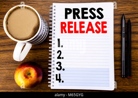 Handwritten text showing Press Release. Business concept for Statement Announcement Message written on notepad paper - Stock Photo