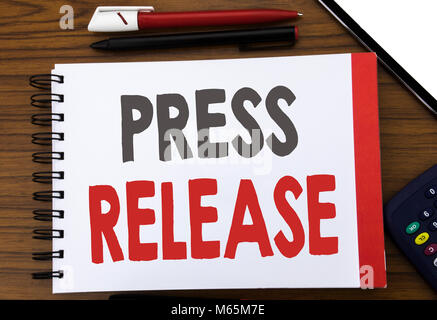 Handwritten text showing Press Release. Business concept writing for Statement Announcement Message Written on notepad - Stock Photo