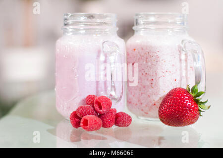Strawberry milk smoothie in a glass jar, well being and weight loos concept. - Stock Photo