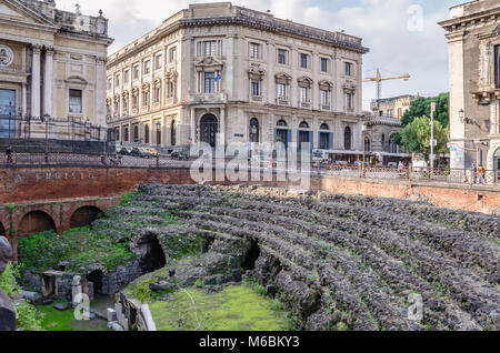 Catania, Italy - November 7, 2015: A view of the Roman Amphitheatre in the middle of the city of Catania. - Stock Photo