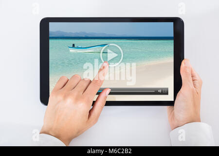 High Angle View Of A Person Watching Video On Digital Tablet - Stock Photo