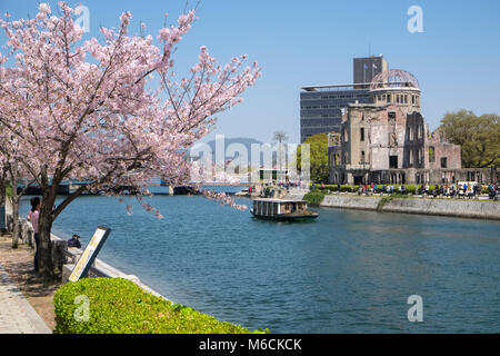 Atomic Bomb Dome building and Ota River, Peace Memorial Park, Hiroshima, Japan - Stock Photo