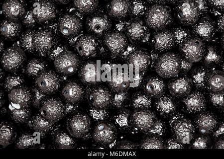 Black beads on macro. High resolution photo. - Stock Photo