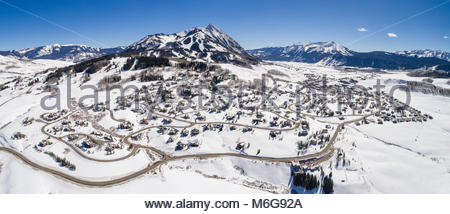 Aerial winter panorama of the snow covered ski village at Mt. Crested Butte, Colorado - Stock Photo