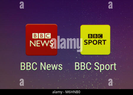 A closeup of the BBC News and BBC Sport apps on a smartphone screen - Stock Photo