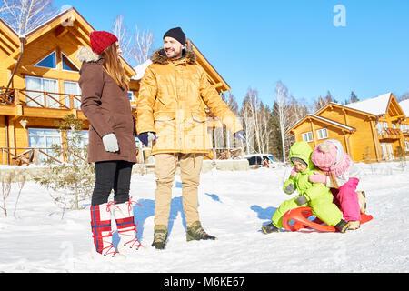Active family on winter holidays - Stock Photo