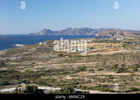 View along north coast of island with Kimolos behind, near Mytakas, Milos, Cyclades, Aegean Sea, Greek Islands; - Stock Photo