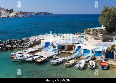 View over fishing harbour with boats and colourful boat houses, Mandrakia, Milos, Cyclades, Aegean Sea, Greek Islands; - Stock Photo