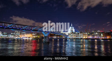 St Paul's Cathedral , the river Thames and the Millennium Bridge at night. London cityscape, showing illuminated - Stock Photo