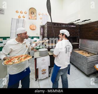 Interior of L'antica Pizzeria da Michele, Naples, Italy. - Stock Photo