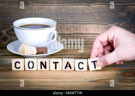 contact. Wooden letters on the office desk, informative and communication background - Stock Photo