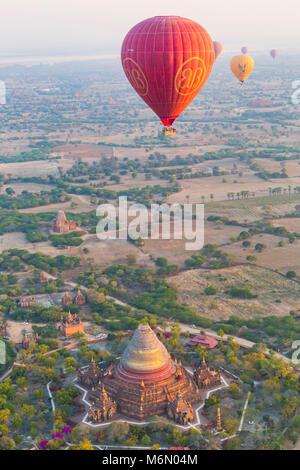 Hot air balloons flying over temples at Bagan at dawn, Myanmar (Burma), Asia in February - Dhama-yar-zi-ka (five - Stock Photo