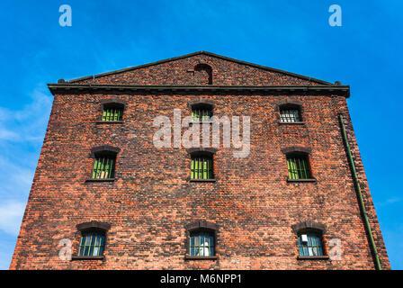 Old industrial victorian brick warehouse ruin in Liverpool, uk. - Stock Photo
