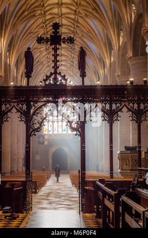 Interior of Tewkesbury Abbey in Worcestershire looking through the rood screen along the aisle to the Norman nave - Stock Photo
