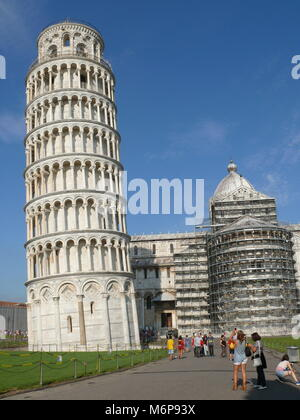 Pisa, Italy, august 2, 2014: The leaning tower and Pisa Cathedral in The square of Miracles - Stock Photo
