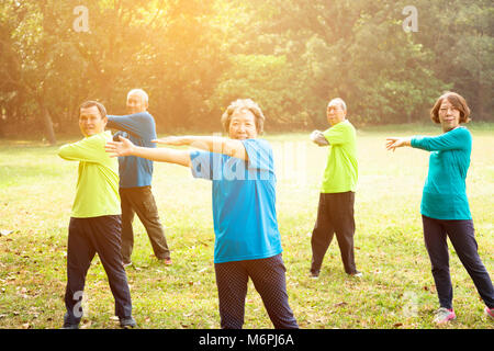 happy Senior Group Friends Exercise in the park - Stock Photo