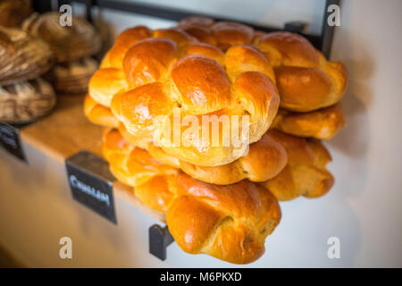 Organic challah bread fresh bake on shelf close up - Stock Photo