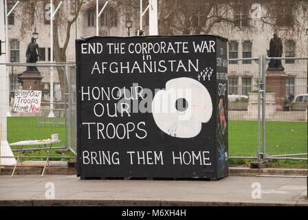 A stand protesting against the war in Afghanistan opposite the Houses of Parliament in Parliament Square, London - Stock Photo