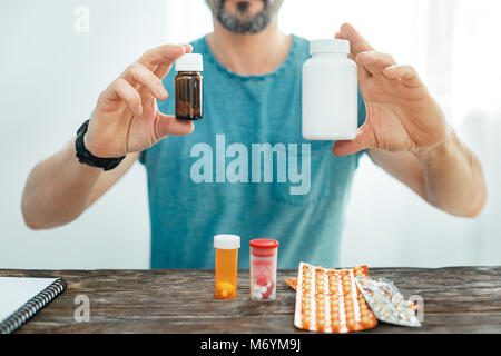 Expensive useful drugs remaining in hand. - Stock Photo