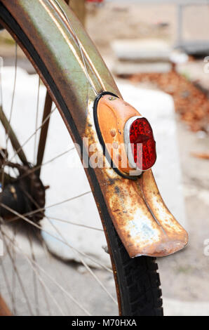 Detail of the back wheel of a rusty vintage bicycle - Stock Photo