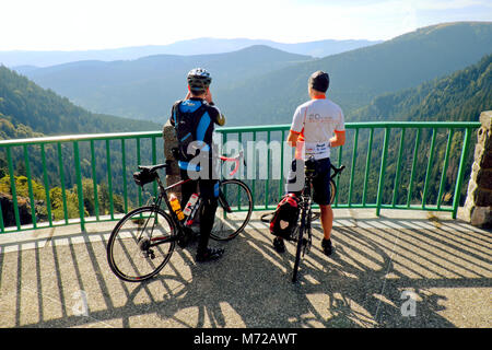 Cyclists along the Route des Crêtes des Vosges Road take in the stunning views of Col de la Schlucht, Vosges Mountains, - Stock Photo