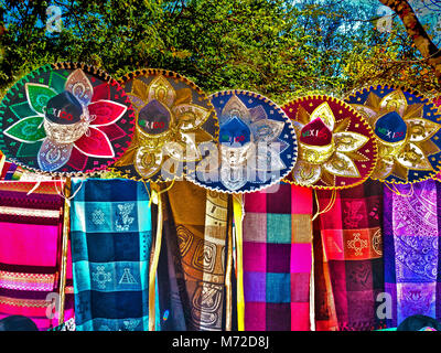 Mexican Sombreros and Colorful Blankets for Sale by a Vendor on the Ground of the Chichen Itza Archaeological Site - Stock Photo