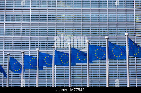 European flags in front of the building of the European Commission, Berlaymont building, Brussels, Belgium, - Stock Photo