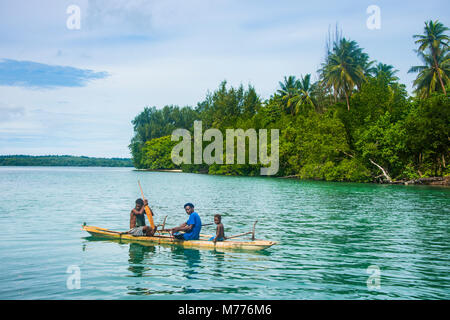 Locals in a dugout canoe, Kavieng, New Ireland, Papua New Guinea, Pacific - Stock Photo