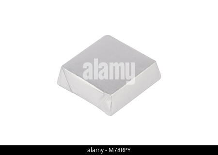 top view closeup of chocolate candy bar wrapped in silver foil packaging isolated on white background - Stock Photo
