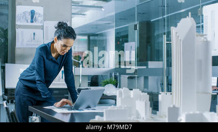 Female Architectural Designer Works on a Laptop,  Engineering New Building Model for the Urban Planning Project. - Stock Photo