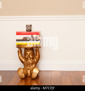 Stack of books on a stool - Stock Photo