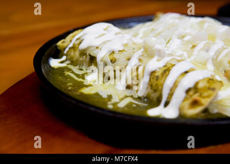 Close-up of enchiladas in a plate - Stock Photo