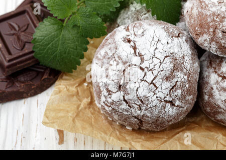 cookies with powdered sugar. Chocolate Crinkles.   Selective focus - Stock Photo