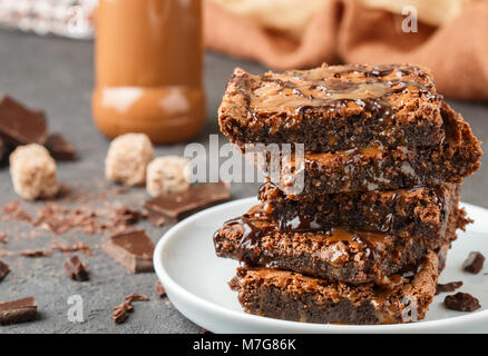 Brownie. Homemade cake with chocolate and caramel. American dessert. Selective focus - Stock Photo