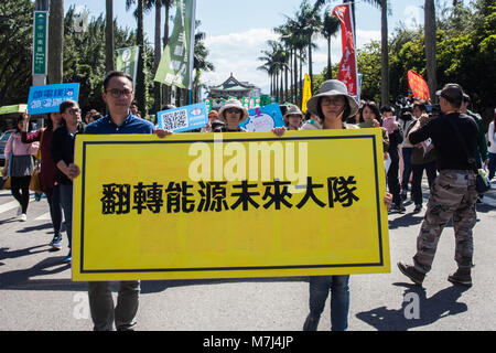 Taipei, Taiwan. 11th Mar, 2018. Anti-Nuclear Activists seen displaying a banner during the annual protest against - Stock Photo