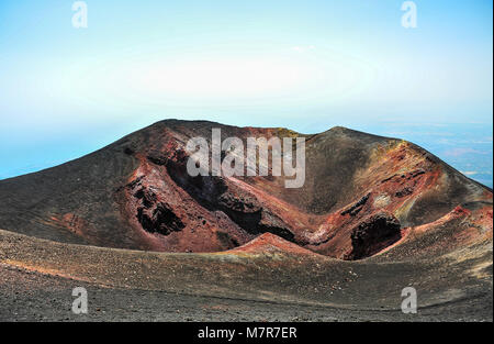 Volcanic crater on Mt Etna in Sicily, Italy - site of the 2002 eruption. Colourful  igneous rock, shades of red, - Stock Photo