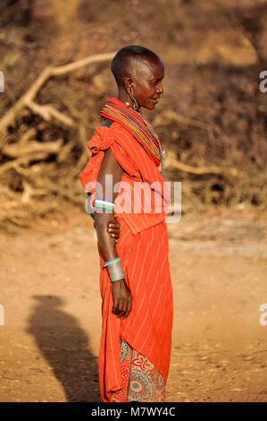 Portrait of an African woman from the Samburu tribe in striking, orange-coloured, traditional dress - Stock Photo